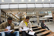 Two students study outside at London Metropolitan University's Holloway Road campus.