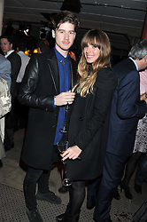 MAX RANDALL and JESS TRINDLE at a party to celebrate the launch of the new Vertu Constellation phone - the luxury phonemakers first touchscreen handset, held at the Farmiloe Building, St.John Street, Clarkenwell, London on 24th November 2011.