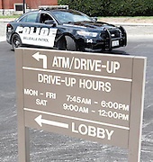 Belleville police officers were helping guard both the old and new banks, and accompanied the Huffman Security moving truck on the road between the two locations. The bank boasts the newest high-tech security and energy conservation systems, and has redundant power supplies in case of a power outage. The bank will open for business at the drive-thru windows at 7:45 a.m. on Monday, and the lobby opens at 9 a.m. -- regular banking hours. This car and officer are stationed at the new location, 215 South Illinois Street.