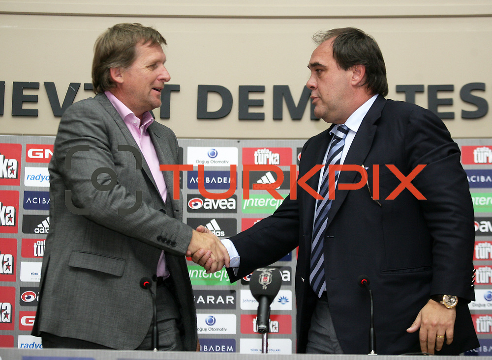 German soccer coach Bernd Schuster (L) shake hands with Chairman of the Besiktas soccer club Yildirim Demiroren (R) during a ceremony in Istanbul June 16, 2010. Istanbul's Besiktas have appointed former Real Madrid coach Schuster as their new technical director in place of Mustafa Denizli, the club announced on June 10. Besiktas agreed a two-year contract with Schuster, who will earn 2.6 million euro a year, it said in a statement to the Istanbul Stock Exchange. Photo by TURKPIX