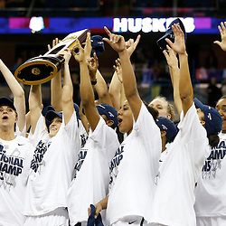 Apr 9, 2013; New Orleans, LA, USA; Connecticut Huskies players hoist the championship trophy after the championship game in the 2013 NCAA womens Final Four against the Louisville Cardinals at the New Orleans Arena. Connecticut defeated Louisville 93-60. Mandatory Credit: Derick E. Hingle-USA TODAY Sports