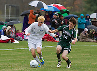 Gilford's Tyler Hanf and Newfound's Brad MacDonald charge the ball during the second round of tournament play for NHIAA Division III soccer Thursday afternoon.  (Karen Bobotas/for the Laconia Daily Sun)