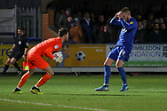 Burton Albion goalkeeper Kieran O'Hara (1) saves a through ball with AFC Wimbledon striker Joe Pigott (39) chasing and with head in hands during the EFL Sky Bet League 1 match between AFC Wimbledon and Burton Albion at the Cherry Red Records Stadium, Kingston, England on 28 January 2020.