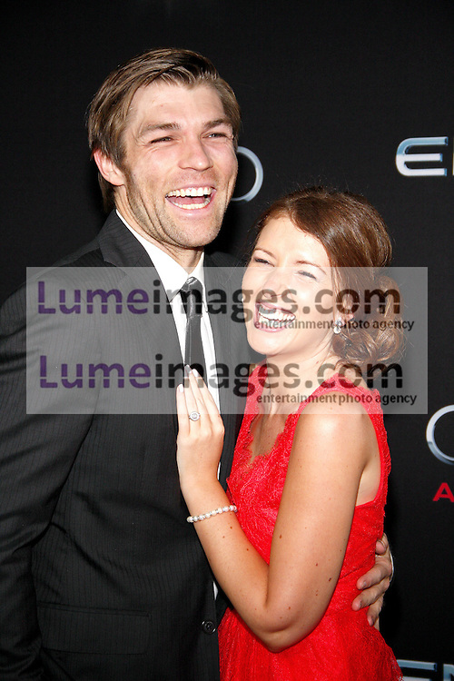 """Liam McIntyre and Erin Hasan at the Los Angeles premiere of """"Ender's Game"""" held at the TCL Chinese Theatre in Hollywood, USA on October 28, 2013."""