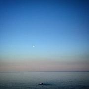 Crete. Somebody swimming in the sea. #greece #sea #swimmer #evening #sundown #crete #blue