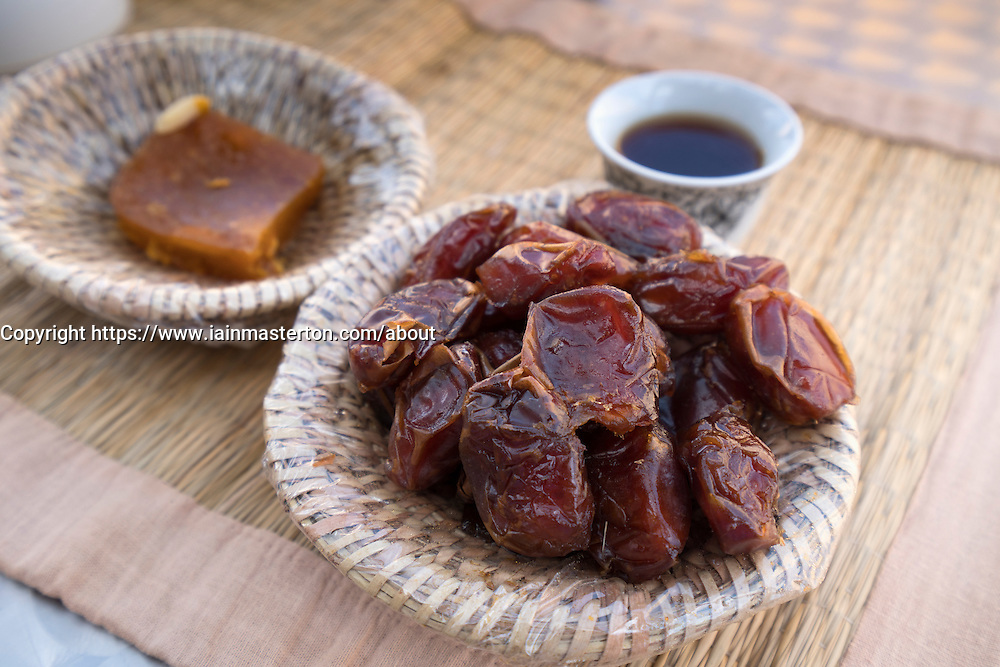 Traditional Oman breakfast of Dates, coffees and Halwa