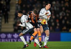 Hull City's Josh Tymon (centre) pushes through Manchester United's Jesse Lingard (left) and Zlatan Ibrahimovic (right)