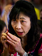 16 FEBRUARY 2018 - BANGKOK, THAILAND: Women pray at Wat Mangkon Kamalawat during Chinese New Year celebrations in the Chinatown neighborhood of Bangkok. Thailand has a large Chinese community and Lunar New Year is widely celebrated, especially in larger cities. This will be the Year of the Dog.       PHOTO BY JACK KURTZ