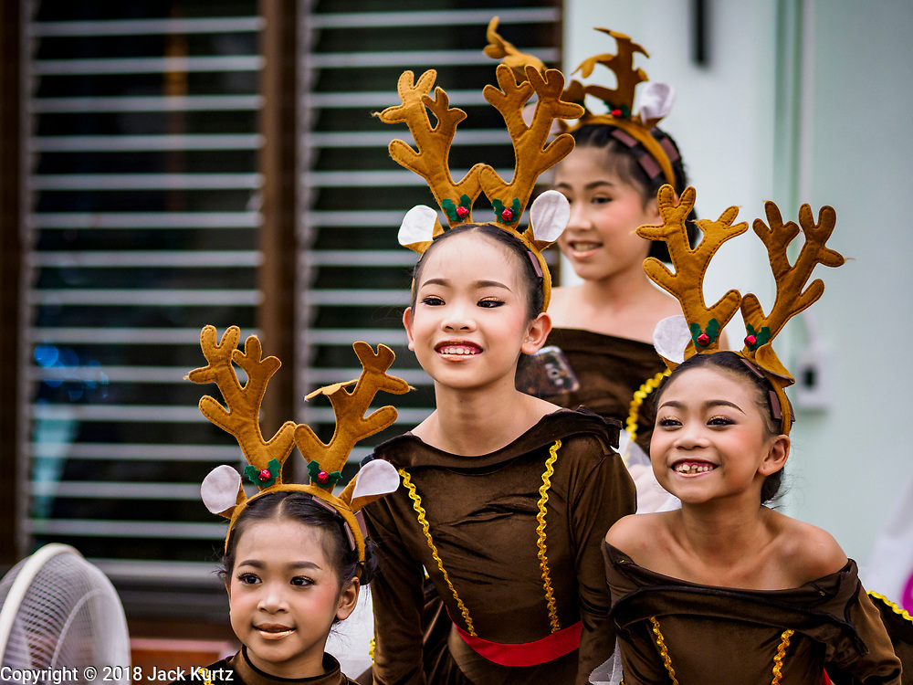 """23 DECEMBER 2018 - CHANTABURI, THAILAND: Girls playing reindeer in the Christmas pageant get ready for the show at the Cathedral of the Immaculate Conception's Christmas Fair in Chantaburi. Cathedral of the Immaculate Conception is holding its annual Christmas festival, this year called """"Sweet Christmas @ Chantaburi 2018"""". The Cathedral is the largest Catholic church in Thailand and was founded more than 300 years ago by Vietnamese Catholics who settled in Thailand, then Siam.  PHOTO BY JACK KURTZ"""