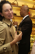 Paula Reed and Michael Roberts, Christopher Bailey hosts a party to celebrate the launch of ' The Snippy World of New Yorker Fashion Artist Michael Roberts' Burberry, New Bond St.  London. 19  September 2005. ONE TIME USE ONLY - DO NOT ARCHIVE © Copyright Photograph by Dafydd Jones 66 Stockwell Park Rd. London SW9 0DA Tel 020 7733 0108 www.dafjones.com