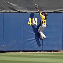 February 26, 2011; Port Charlotte, FL, USA; Pittsburgh Pirates center fielder Andrew McCutchen jumps as the ball flies over the fence for a homerun by Tampa Bay Rays third baseman Evan Longoria (not pictured) during a spring training exhibition game at Charlotte Sports Park. The Rays defeated the Pirates 9-5.  Mandatory Credit: Derick E. Hingle