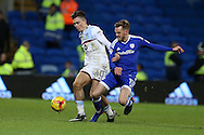 Jack Grealish of Aston Villa (l) is tackled hard by Craig Noone of Cardiff city. EFL Skybet championship match, Cardiff city v Aston Villa at the Cardiff City Stadium in Cardiff, South Wales on Monday 2nd January 2017.<br /> pic by Andrew Orchard, Andrew Orchard sports photography.