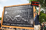 Message from the Union of Concerned Scientists that climate change affects us all on a black board at the Climate March in Washington D.C.