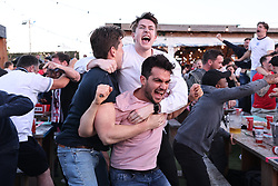 © Licensed to London News Pictures. 07/07/2021. London, UK. England fans at Tobacco Dock react while watching the Euro 2020 semi-final between England and Denmark begins at Wembley Stadium. Photo credit: Rob Pinney/LNP