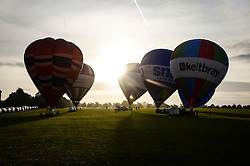 Balloons inflate in preparation for flight from Clifton Downs, Bristol, as balloonists gather to mark less than a week to go until the start of the Bristol International Balloon Fiesta.