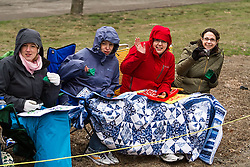 fans in Newton Hills stay bundled up in the wet and windy weather