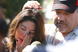 Las Vegas mass shooting survivors Johanna Ernst, left, of the San Francisco Bay area, and her boyfriend George Sanchez, of San Diego, are overcome with emotion while speaking to the news media on the Las Vegas Strip Tuesday, Oct. 3, 2017, in Las Vegas. Sanchez suffered a bullet wound to his left arm Sunday evening while the couple attended the Route 91 Harvest country music festival. (Photo by Ronda Churchill/ZUMA Press)