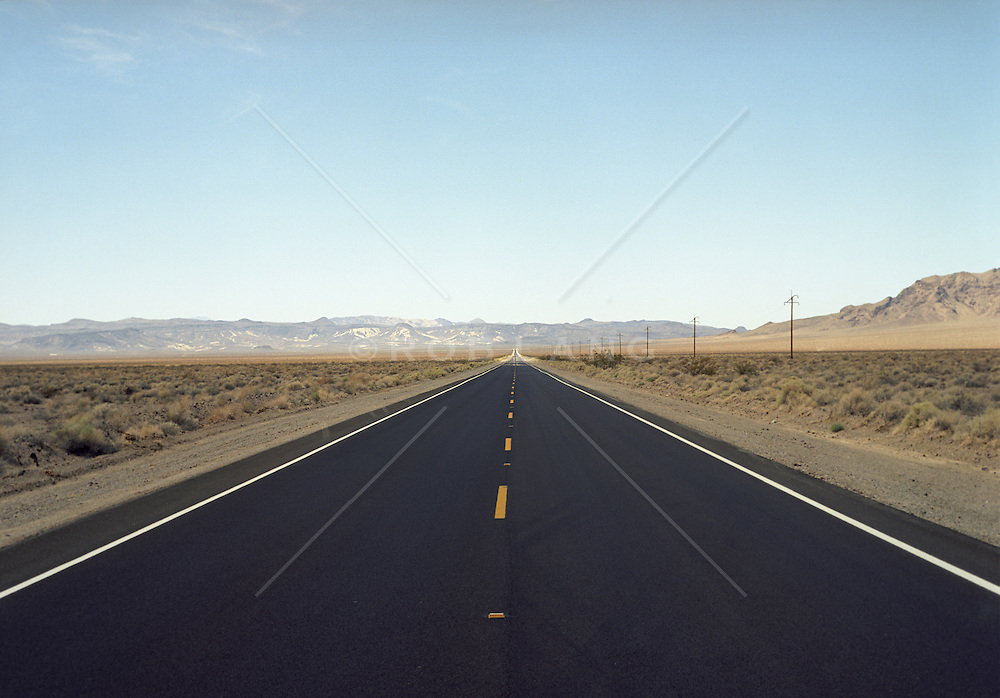 Empty paved road in New Mexico