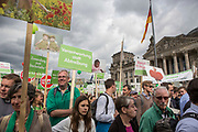 """Participants in """"The March For Life"""" are seen carrying  banners as they march in front of the Bundestag in Berlin's Mitte district, on September 16, 2017. In the center of the pro-life event was the call by the organizers for German politicians and society to take active action against a """"silent increase of acceptance"""" of the phenomenon. Abortion in Germany is permitted in the first trimester of the pregnancy, with the condition of mandatory counseling and in a later period of the pregnancy in cases of medical necessity.<br /> (Photo by Omer Messinger)"""