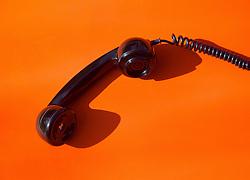 Telephone Handset on Orange Background
