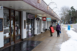 Aviemore, Scotland, UK. 4 February 2021. General views of Main Street and closed businesses in Aviemore. At what would be peak season for winter sports, Avemore in the Scottish Highlands lies deserted  during lockdown, with all non essential shops and cafes closed.. The Main Street is normally busy with outdoor sport tourists all year round. Iain Masterton/Alamy Live News