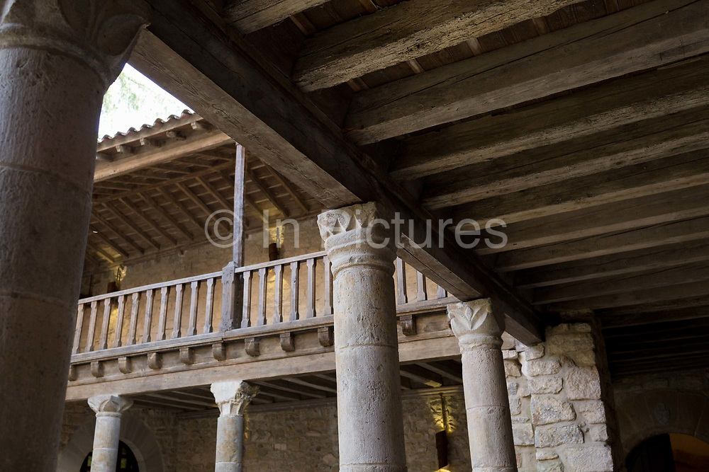 Architecture in the inner courtyard of the Abbots Dwelling at the Abbey of Sante-Marie DOrbieu, on 21st May 2017, in Lagrasse, Languedoc-Rousillon, south of France. Lagrasse is listed as one of Frances most beautiful villages and lies on the famous Route 20 wine route in the Basses-Corbieres region dating to the 13th century.