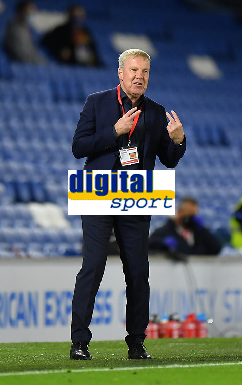 Football - 2020 / 2021 EFL Cup - Round Two - Brighton & Hove Albion vs Portsmouth<br /> <br /> Portsmouth manager Kenny Jackett shouts instructions to his team from the technical area, at the Amex Stadium.<br /> <br /> COLORSPORT/ASHLEY WESTERN