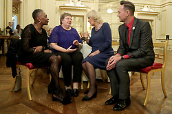 The Duchess of Cornwall, President of the National Osteoporosis Society, accompanied by 'Strictly Come Dancing' judge Craig Revel Horwood talks to guests as she hosts a tea dance at Buckingham Palace in London attended by 'Strictly Come Dancing' dancers and judges to highlight the benefits for older people of staying active.