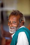 Venugopal waits before an exercise class at the Tamaraikulum Elders village, Tamil Nadu, India