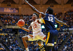 Feb 9, 2019; Morgantown, WV, USA; Texas Longhorns guard Kerwin Roach II (12) shoots in the lane during the first half against the West Virginia Mountaineers at WVU Coliseum. Mandatory Credit: Ben Queen-USA TODAY Sports