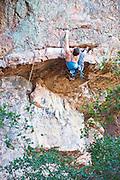 Val Hooper climbing Cosmos (5.11b) at Pinnacles National Monument, California