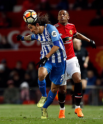 Brighton & Hove Albion's Ezequiel Schelotto (left) and Manchester United's Anthony Martial battle for the ball during the Emirates FA Cup, quarter final match at Old Trafford, Manchester.