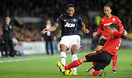 Antonio Valencia of Manchester United is tackled by Andrew Taylor of Cardiff City.<br /> Barclays Premier League match, Cardiff city v Manchester Utd at the Cardiff city stadium in Cardiff, South Wales on Sunday 24th Nov 2013. pic by Phil Rees, Andrew Orchard sports photography,