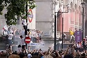 Hours before the England football team play an historic game against Italy the first time since 1966 that the English national team have played in a major mens' international football final, thousands of mainly young supporters crowd without face coverings nor social distancing outside Leicester Square tube station, on 11th July 2021, in London, England.