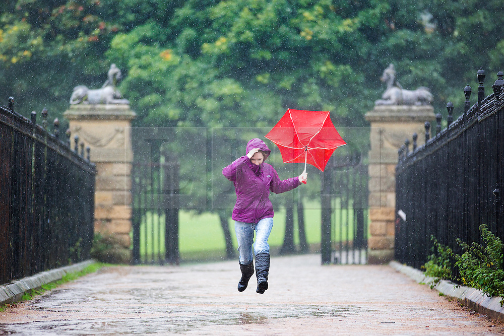 © Licensed to London News Pictures. 07/10/2015. Leeds, UK. Picture shows a woman running through the rain at Temple Newsam park in Leeds. Photo credit: Andrew McCaren/LNP