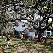 Jones DuBose, 12, of Columbia, left, and Sarah DuBose, 14, of Columbia, right, push their younger brother Sam DuBose, 10, of Columbia, center, on a tree swing while soaking in some sun and enjoying their weekend along the May River in Bluffton on April 3, 2015.
