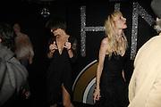 Milla Jovavich and Carmen Hawks, MILLA JOVOVICH, CARMEN HAWK & HARVEY NICHOLS CELEBRATE THE LAUNCH OF JOVOVICH-HAWK. FIFTH FLOOR CAFƒ. HARVEY NICHOLS. london.  27 April 2006. ONE TIME USE ONLY - DO NOT ARCHIVE  © Copyright Photograph by Dafydd Jones 66 Stockwell Park Rd. London SW9 0DA Tel 020 7733 0108 www.dafjones.com