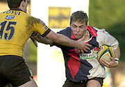 Wycombe, Buckinghamshire, 29th February 2004, Adams Park, [Mandatory Credit; Peter Spurrier/Intersport Images],<br /> 29/02/2004  -  Powergen  Cup - London Wasps v Pertemps Bees <br /> Bees Dave Knight is tackled by Wasps Tom Voyce.