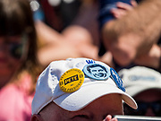 13 AUGUST 2019 - DES MOINES, IOWA: Pete Buttigieg buttons on the hat of a Buttigieg supporter at the Des Moines Register Political Soap Box. Buttigieg, the Mayor of South Bend, Indiana, is running to be the Democratic nominee for the US presidency. He spoke at the Des Moines Register Political Soap Box at the Iowa State Fair and then toured the fairgrounds. Iowa has the first event of the presidential selection cycle. The Iowa Caucuses are February 3, 2020.               PHOTO BY JACK KURTZ