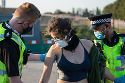West Hyde, UK. 14th September, 2020. Hertfordshire Police arrest an environmental activist from HS2 Rebellion who, together with another activist, had used a lock-on arm tube to block a gate to the South Portal site for the HS2 high-speed rail link. Anti-HS2 activists blocked two gates to the same works site for the controversial £106bn rail link, one remaining closed for over six hours and another for over nineteen hours.
