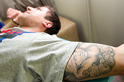 Tattoo of Mitja Robar of Slovenian National Ice Hockey team in a massage room in the hotel Holiday Inn at IIHF 2011 World Championship Slovakia, on May 4, 2011 in Bratislava, Slovakia. (Photo By Vid Ponikvar / Sportida.com)