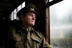© Licensed to London News Pictures. <br /> 15/10/2016. <br /> Pickering, UK.  <br /> <br /> A man dressed as a British World War Two officer sits on the train on route to Pickering station during the North Yorkshire Moors Railway Wartime Weekend event. <br /> The annual event brings together re-enactors and enthusiasts along the length of the NYMR heritage steam railway line to recreate the feel of the war years of the 1940's. <br /> <br /> Photo credit: Ian Forsyth/LNP