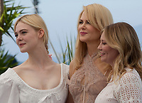 Elle Fanning, Nicole Kidman and Kirsten Dunst at the The Beguiled film photo call at the 70th Cannes Film Festival Wednesday 24th May 2017, Cannes, France. Photo credit: Doreen Kennedy