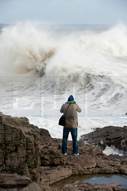 © Licensed to London News Pictures. 21/10/2014. Mid Glamorgan, Wales, UK. Waves crash against the harbour wall. The tail end of Hurricane Gonzalo arrives on the Welsh coast bringing storm force winds and heavy rainfall. Photo credit: Graham M. Lawrence/LNP