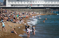 © Licensed to London News Pictures. 03/07/2018. Brighton, UK. Members of the public flock to the beach to enjoy the continued hot weather on the seafront at Brighton on the south coast of England. Photo credit: Ben Cawthra/LNP