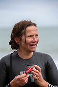 Award winning actress and Folkestone resident Jessica Hynes completed a 4 mile sea swim on the 7th of July 2020 with 12 laps of Folkestone sunny sands bay to raise money for charity in Folkestone, Kent. She swam for two different charities, one being the Folkestone community hub, which has been supporting vulnerable people during the Covid-19 lockdown and the second called Green Kordofan which supports children in a refugee camp in Yida, South Sudan. Mrs Hynes is one of many volunteers who have worked at the hub, which provides help by delivering groceries, collecting prescriptions or just being a voice on the end of the phone.The second charity is Green Kordofan, which supports children in a refugee camp in Yida, South Sudan and was founded by Raga Gibreel, also from Folkestone.The registered charity is currently raising money for essential hygiene facilities such as washing and toilet blocks, to make the camp safe for the children who have been displaced by war. (photo by Andrew Aitchison / In pictures via Getty Images)