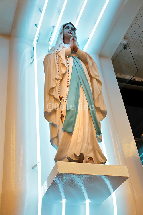 Statue of Mary at a souvenir shop in Lourdes, France