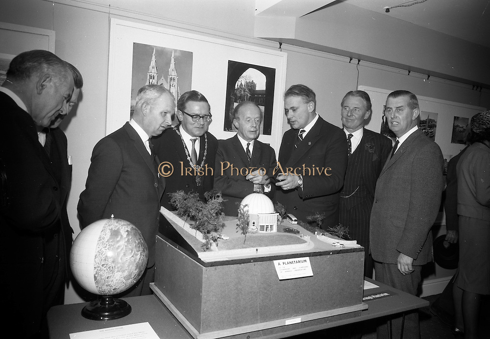 22/03/1966<br /> 03/22/1966<br /> 22 March 1966<br /> Northern Ireland tourist Board Exhibition at the Little Theatre, Brown Thomas in Dublin. Picture shows Mr patrick Moore (3rd from right), Director, Armagh Observatory, showing a model of the planned Armagh Planetarium to l-r: Dr J.J. O'Driscoll, Director General, Bord Failte; Mr Brendan O'Regan, Chairman of Bord Failte; Mr Brian Faulkner, Northern Ireland Minister of Commerce; Alderman Eugene Timmons, Lord Mayor of Dublin; Mr Erskine Childers, Minister for Transport and Power, who opened the exhibition and Mr W.L. Stephens, Chairman Northern Ireland Tourist Board. Gentleman on far right is unnamed.