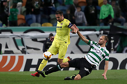 February 14, 2019 - Lisbon, Portugal - Villarreal's defender Mario Gaspar (L) vies with Sporting's forward Bas Dost from Holland during the UEFA Europa League Round of 32 First Leg football match Sporting CP vs Villarreal CF at Alvalade stadium in Lisbon, Portugal on February 14, 2019. (Credit Image: © Pedro Fiuza/ZUMA Wire)
