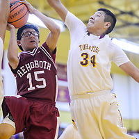 Rehoboth Lynx Vinell Mariano (15) is blocked by Tohatchi Cougar Brennen Chee (34) Thursday at Tohatchi High School.